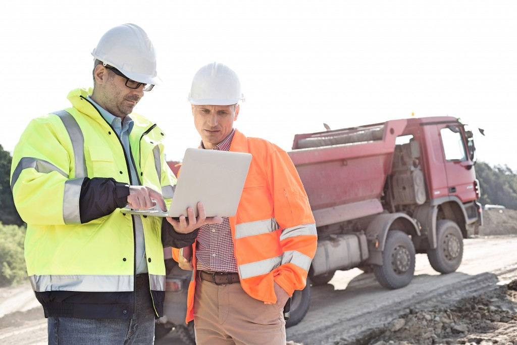 construction workers using laptop